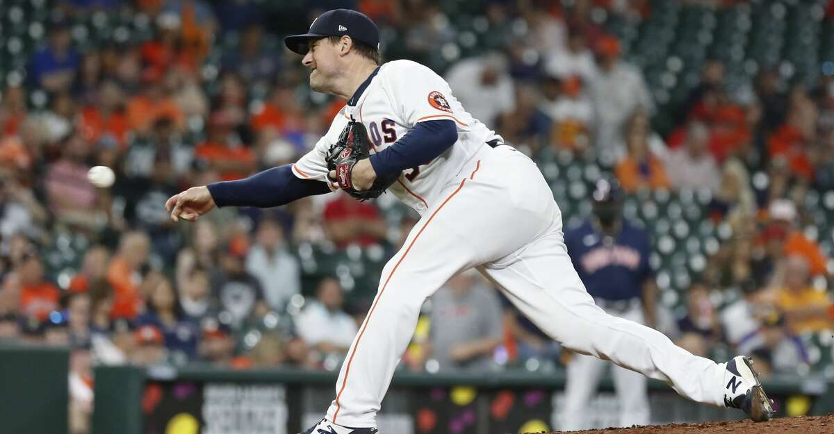 Houston Astros relief pitcher Joe Smith (38) pitches during the eighth inning of an MLB baseball game at Minute Maid Park, Thursday, June 3, 2021, in Houston.