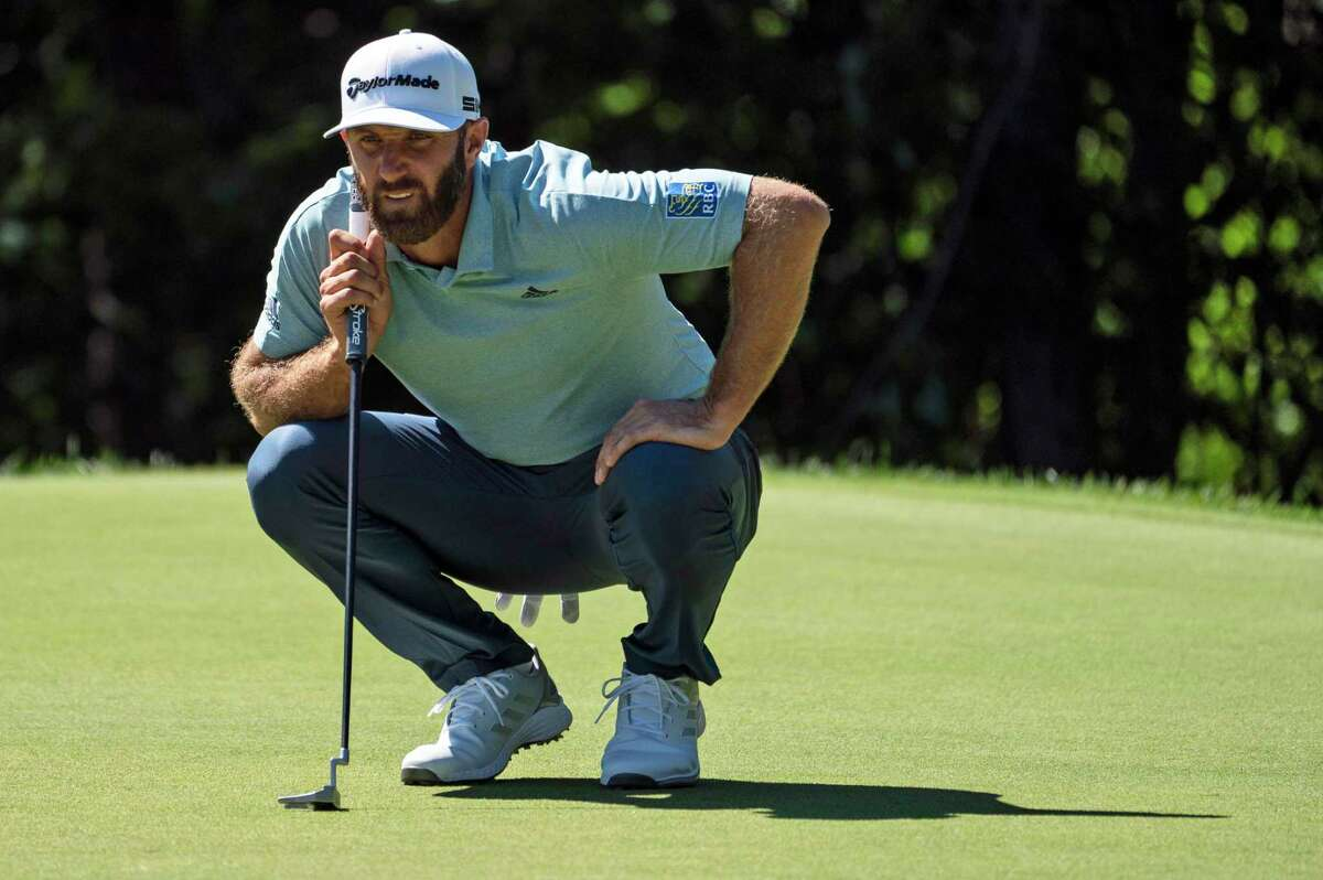 Dustin Johnson lines up his putt on the 11th green during the first round on Thursday.