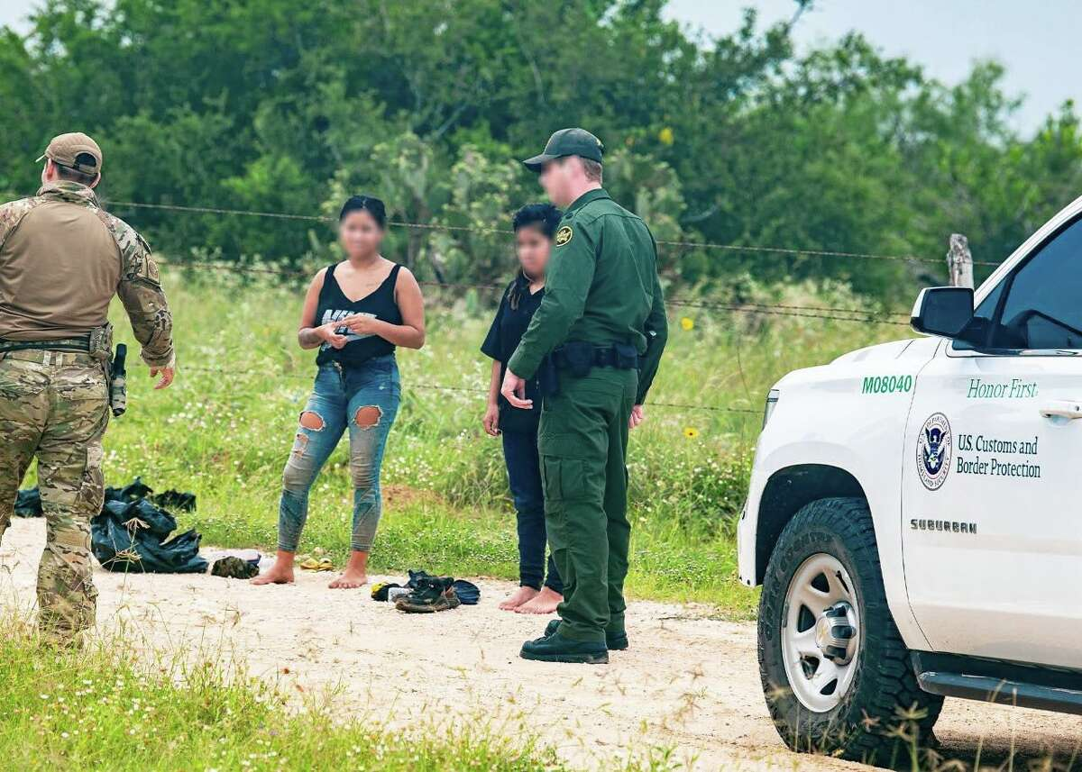 U.S. Border Patrol agents rescued these two migrants after responding to a report of lost subjects. The migrants managed to climb a windmill to use a cellphone and call for help.