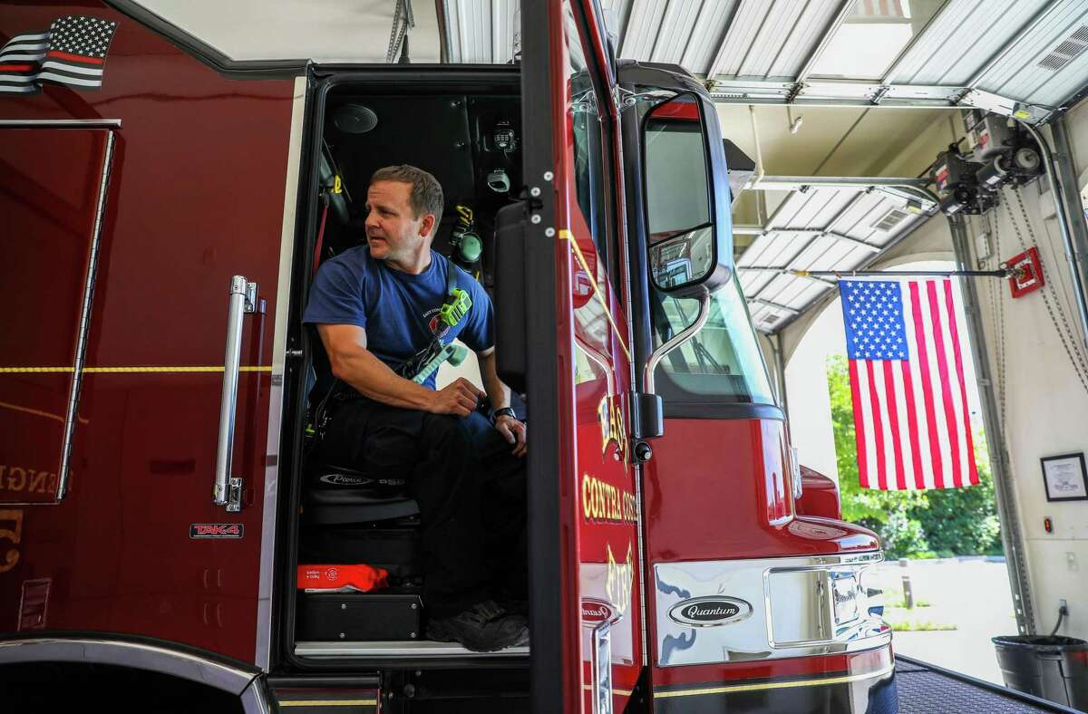 Capt. Robert Ruddick, 44, of Brentwood, prepares to head to an emergency call after hopping into a Type 1 Engine at the East Contra Costa Fire Protection District, Station 52, located at 201 John Muir Parkway, on Thursday, June 17, 2021, in Brentwood, Calif. The fire department averages about 10 calls a day, 350 calls a month and 3,000 calls a year.