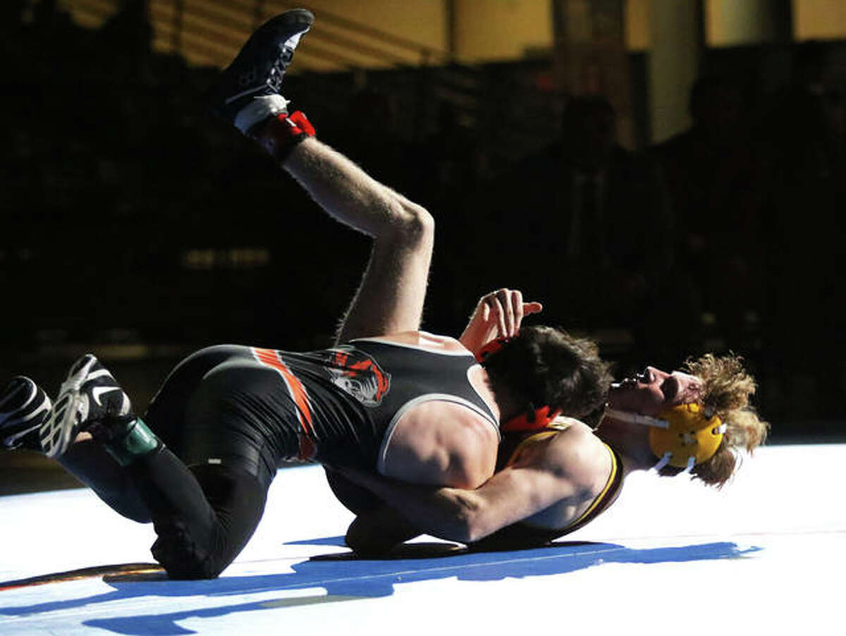 EA-WR's Jason Shaw (right) is taken to the mat for a takedown by Illini Bluffs' Paul Ishikawa as time expires in overtime in the 126-pound championship match Thursday in the IWCOA Class 1A wrestling state meet at Bank of Springfield Center in Springfield.