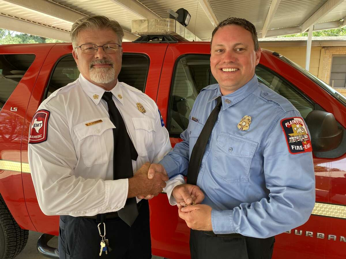 Interim Fire Chief Bobby Gipson stands with recently promoted Chris Chandler who was named Plainview's newest fire marshal.