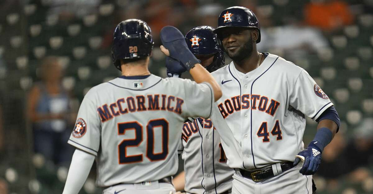 Houston Astros' Yordan Alvarez (44) celebrates his grand slam with Chas McCormick (20) in the ninth inning of a baseball game against the Detroit Tigers in Detroit, Thursday, June 24, 2021. (AP Photo/Paul Sancya)