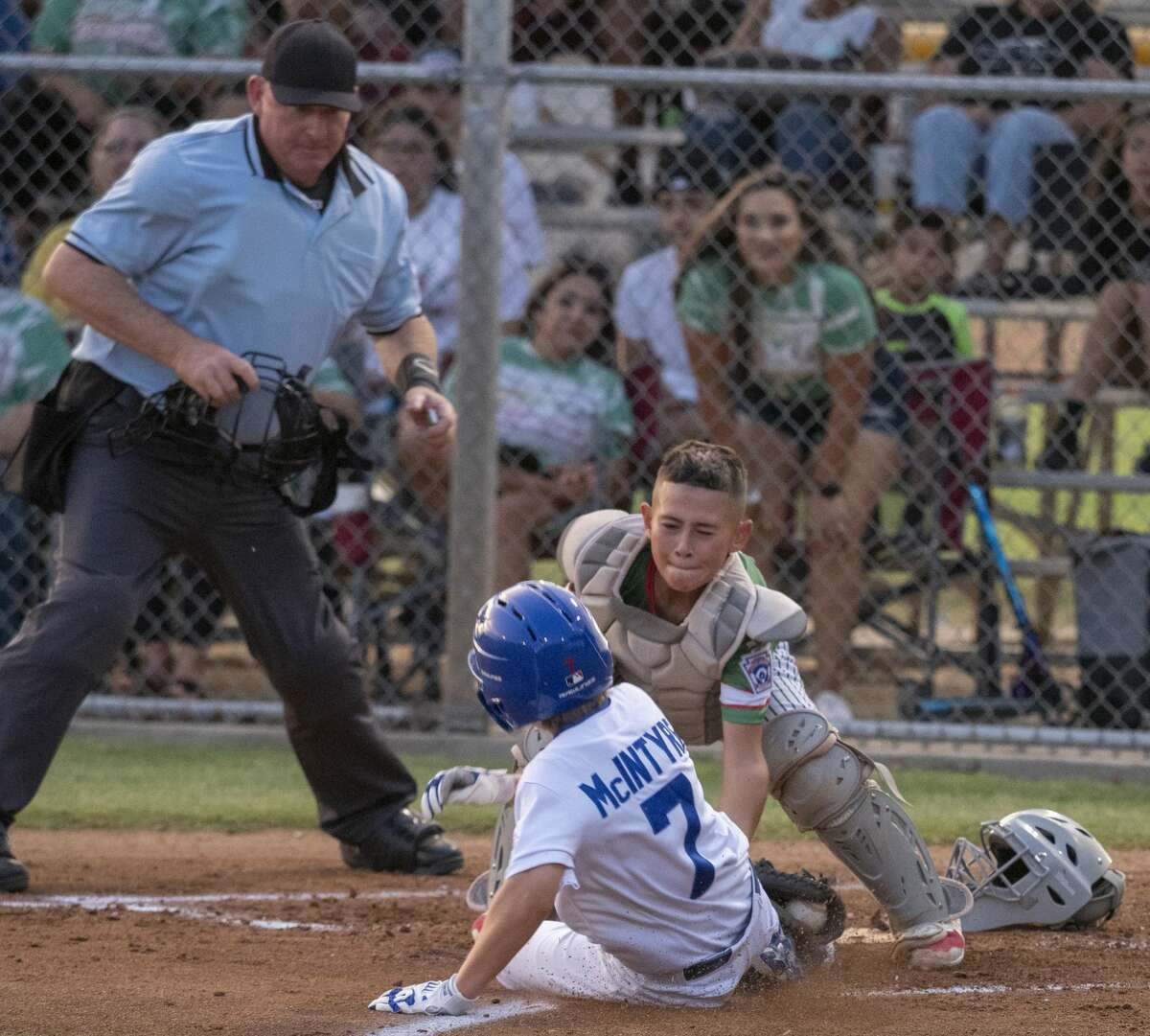 Northern's Brady McIntyre is tagged out at home by Floyd Gwin's catcher 06/24/2021 at Butler Park. Tim Fischer/Reporter-Telegram