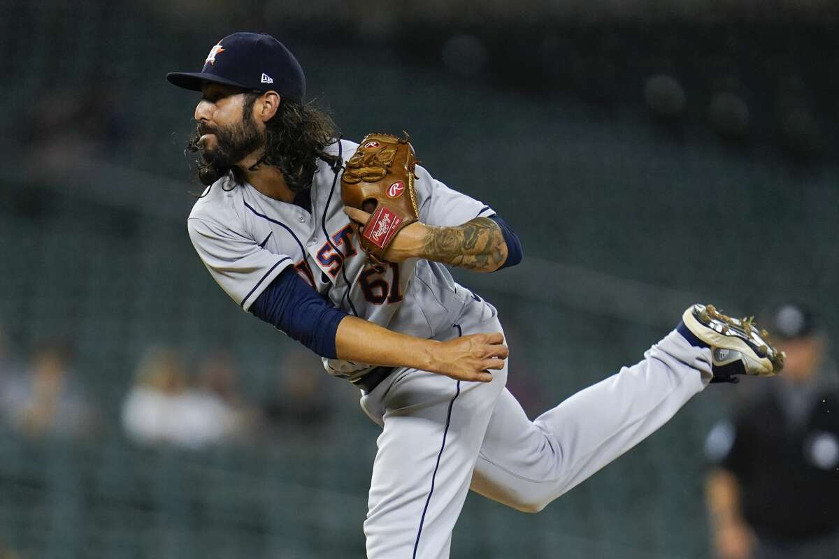 Houston Astros relief pitcher Ralph Garza Jr. throws against the Detroit Tigers in the ninth inning of a baseball game in Detroit, Thursday, June 24, 2021. Houston won 12-3. (AP Photo/Paul Sancya)