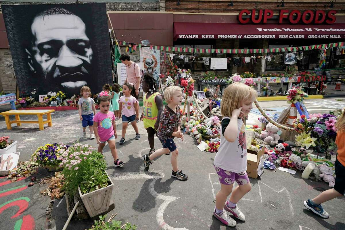 Preschool children visit the site where George Floyd was murdered by then Minneapolis Police officer Derek Chauvin, as the kids took a field trip to the memorial, Thursday, June 24, 2021, in Minneapolis. Chauvin is scheduled to be sentenced on Friday.