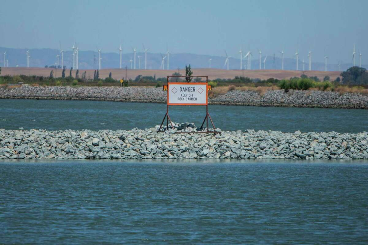 The newly completed salinity barrier that the state Department of Water Resources built in 20 days outside Oakley in the delta.