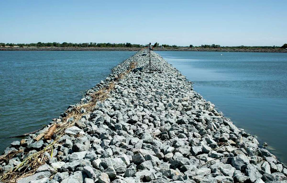 The salinity barrier that the state built on the West False River to keep saltwater from getting into the freshwater.