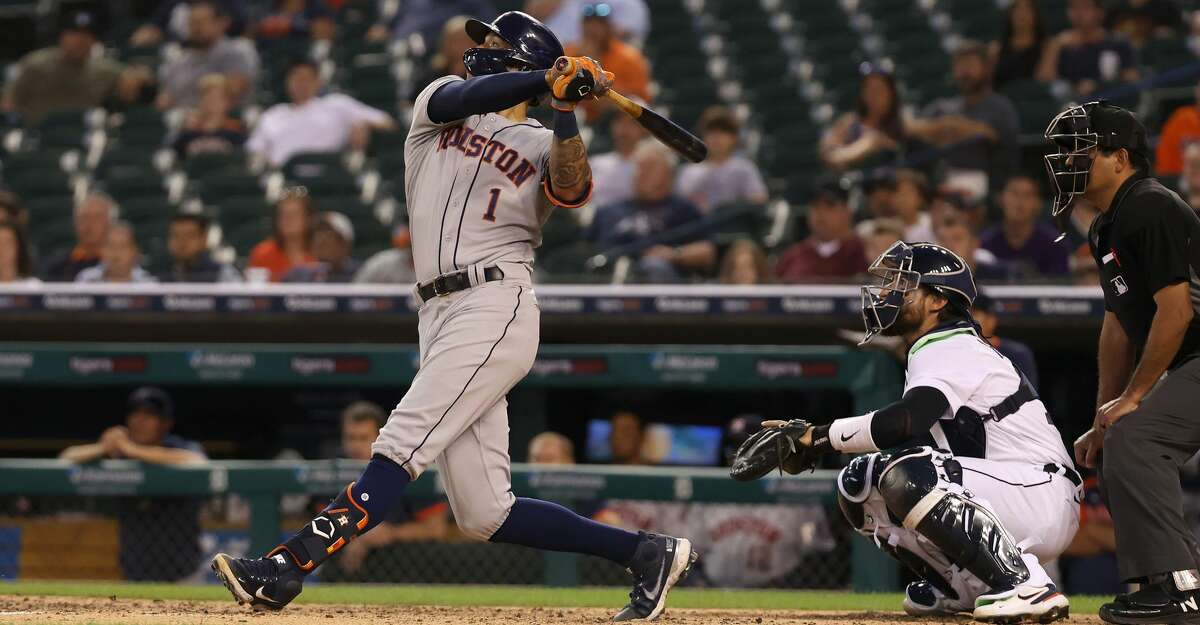 Carlos Correa #1 of the Houston Astros hits a two run single in the fifth inning in front of Eric Haase #13 of the Detroit Tigers at Comerica Park on June 24, 2021 in Detroit, Michigan. (Photo by Gregory Shamus/Getty Images)