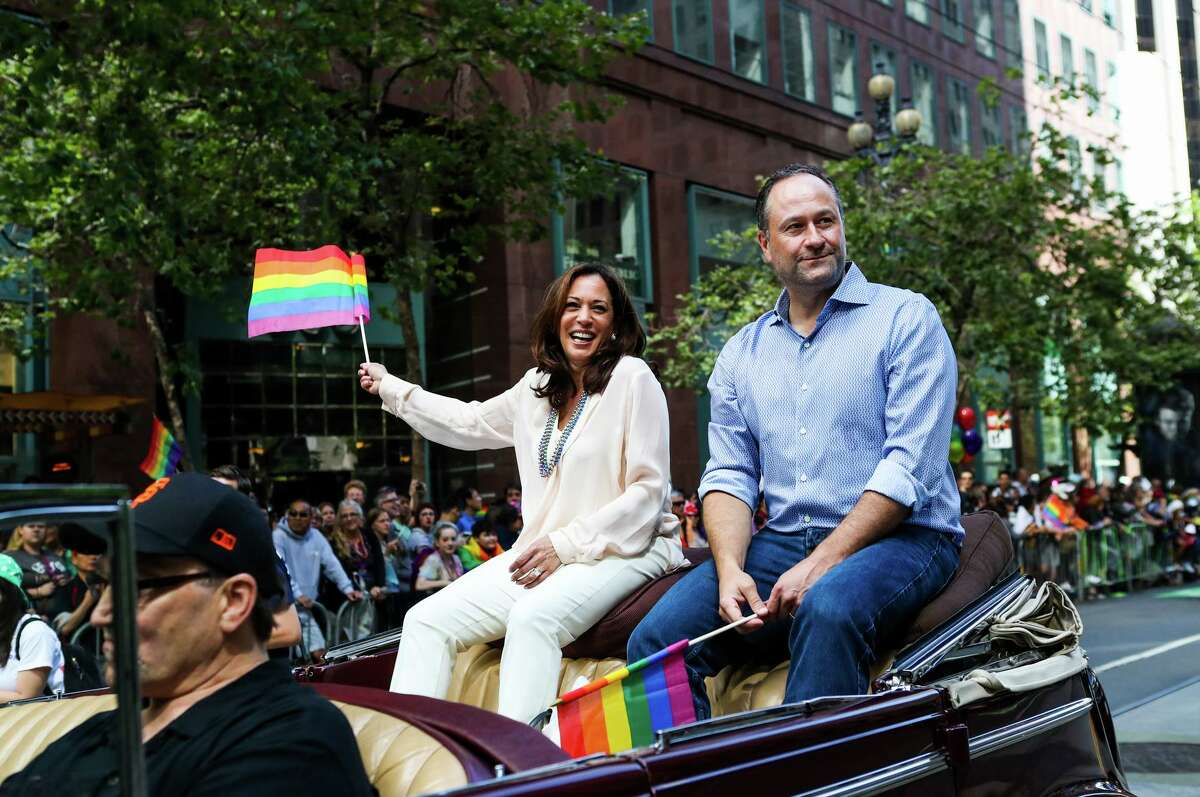 Then-state Attorney General Kamala Harris rides with her husband in San Francisco's LGBT Pride Parade in 2016.