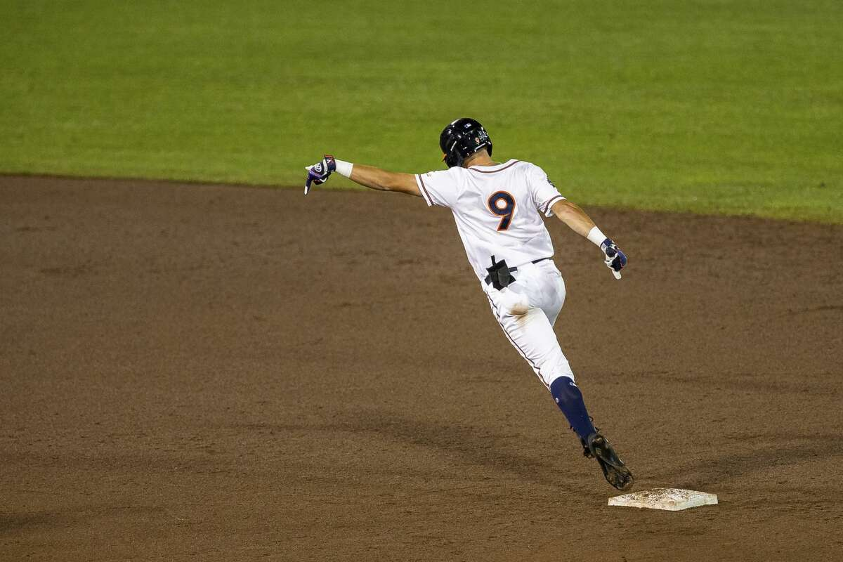 Virginia Chris Newell (9) runs the bases after hitting a two run homer in the fifth inning during a baseball game in the College World Series Thursday, June 24, 2021, at TD Ameritrade Park in Omaha, Neb. (AP Photo/John Peterson)