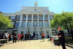 YWCA Greenwich Director of Women's Empowerment, Erin O. Crosby, speaks during its Stand Against Racism event outside of Greenwich Town Hall April 23, 2021.