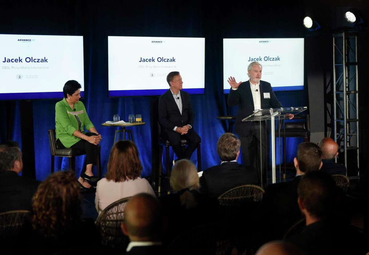 AdvanceCT Co-Chair Indra Nooyi, left, Gov. Ned Lamont, center, and Philip Morris International CEO Jacek Olczak discuss the company's plan to move its headquarters from New York City to Connecticut during an event at The Village complex in Stamford, Conn., on Tuesday, June 22, 2021.