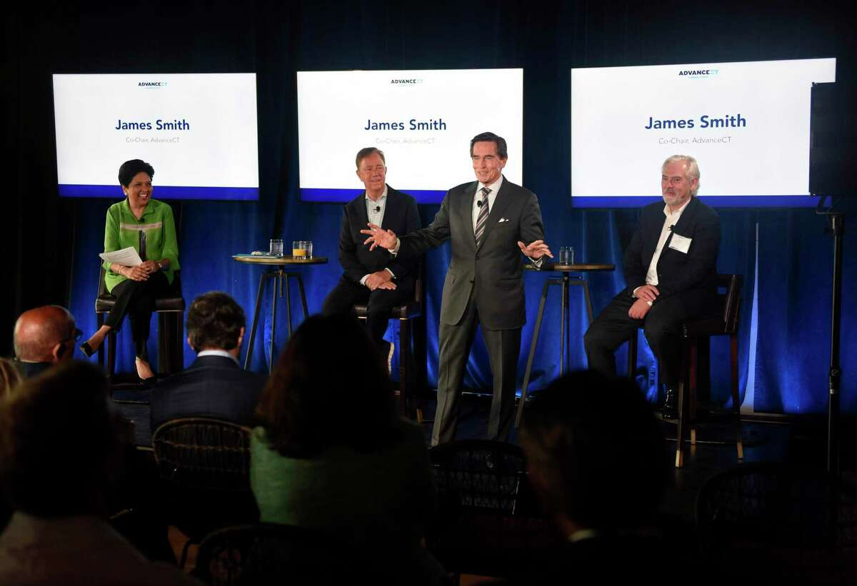 AdvanceCT Co-Chair James Smith, second from right, discusses Philip Morris International's plan to move its headquarters from New York City to Connecticut during an event at The Village complex in Stamford, Conn., on Tuesday, June 22, 2021.