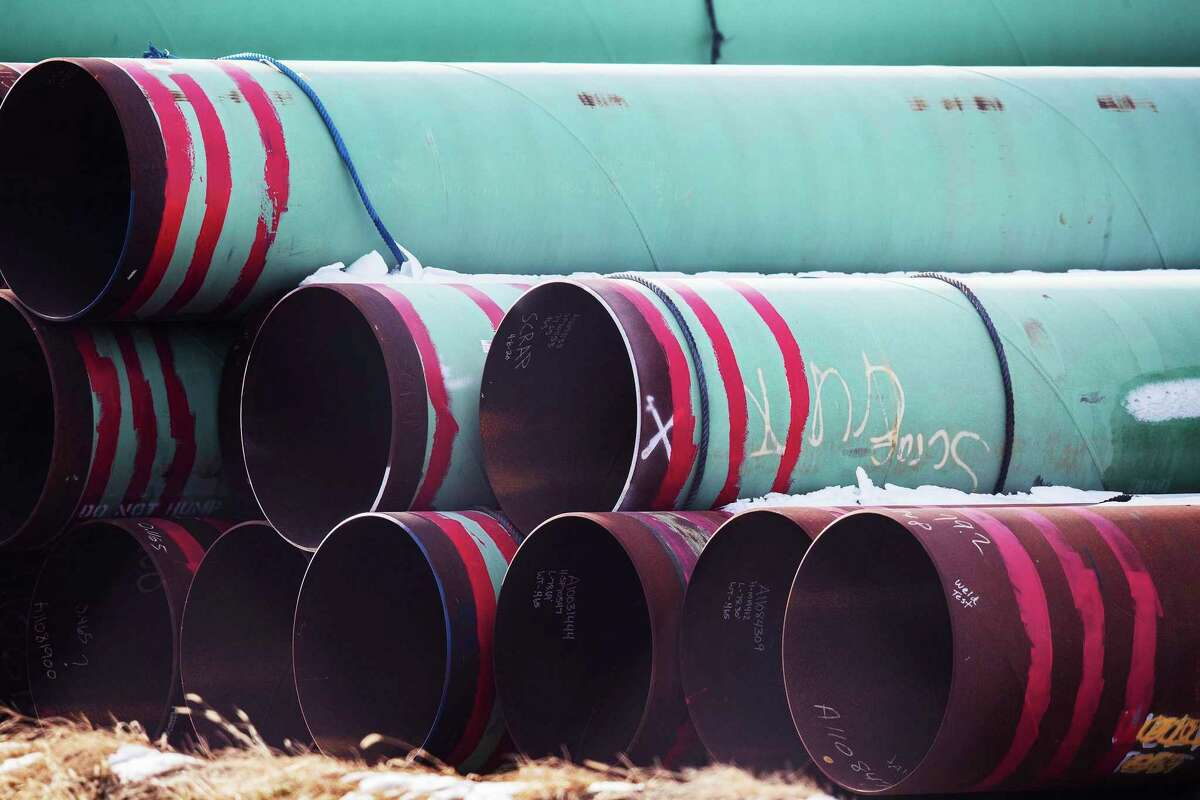 This file photo shows pipes that were to be used for the Keystone XL pipeline., which was recently canceled by TC Energy. Pipelines face a tougher regulatory terrain.