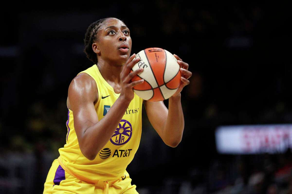 Forward Nneka Ogwumike #30 of the Los Angeles Sparks, takes a free throw against the Dallas Wings at Staples Center on July 18, 2019 in Los Angeles, California.