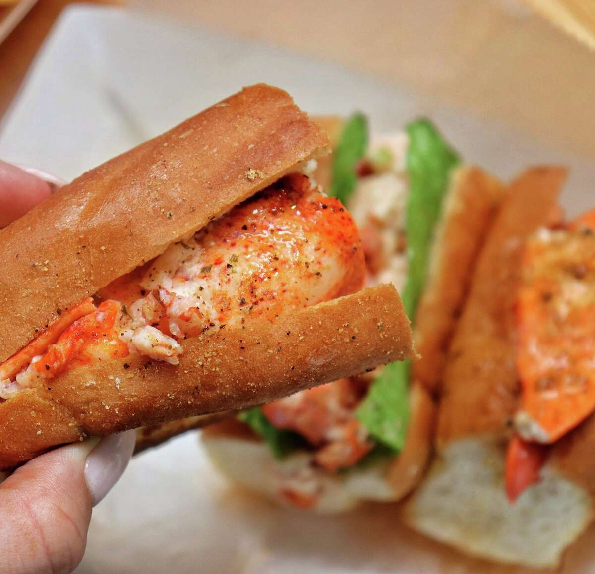 """Can't decide on a lobster roll? Try a flight of sliders: hot buttered, """"Dirty Maynard"""" with mayonnaise and the """"Heat Wave"""" with pepper-infused butter."""
