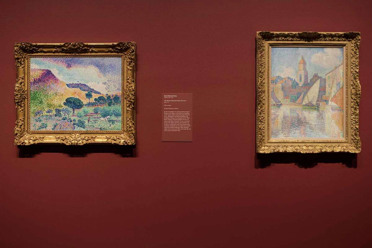 """""""The Maures Mountain Chain, Provence"""" by Henri-Edmond Cross and """"The Bell Tower of Saint-Tropez"""" by Paul Signac are part of Three Centuries of American Art from the Sarofim collection at Museum of Fine Arts Houston Thursday, June 24, 2021 in Houston. The Sarofim collection is part of two new exhibits at the museum. The other is titled Monet to Matisse: Impressionism to Modernism from the Bemberg Foundation, it covers impressionism through modernism."""