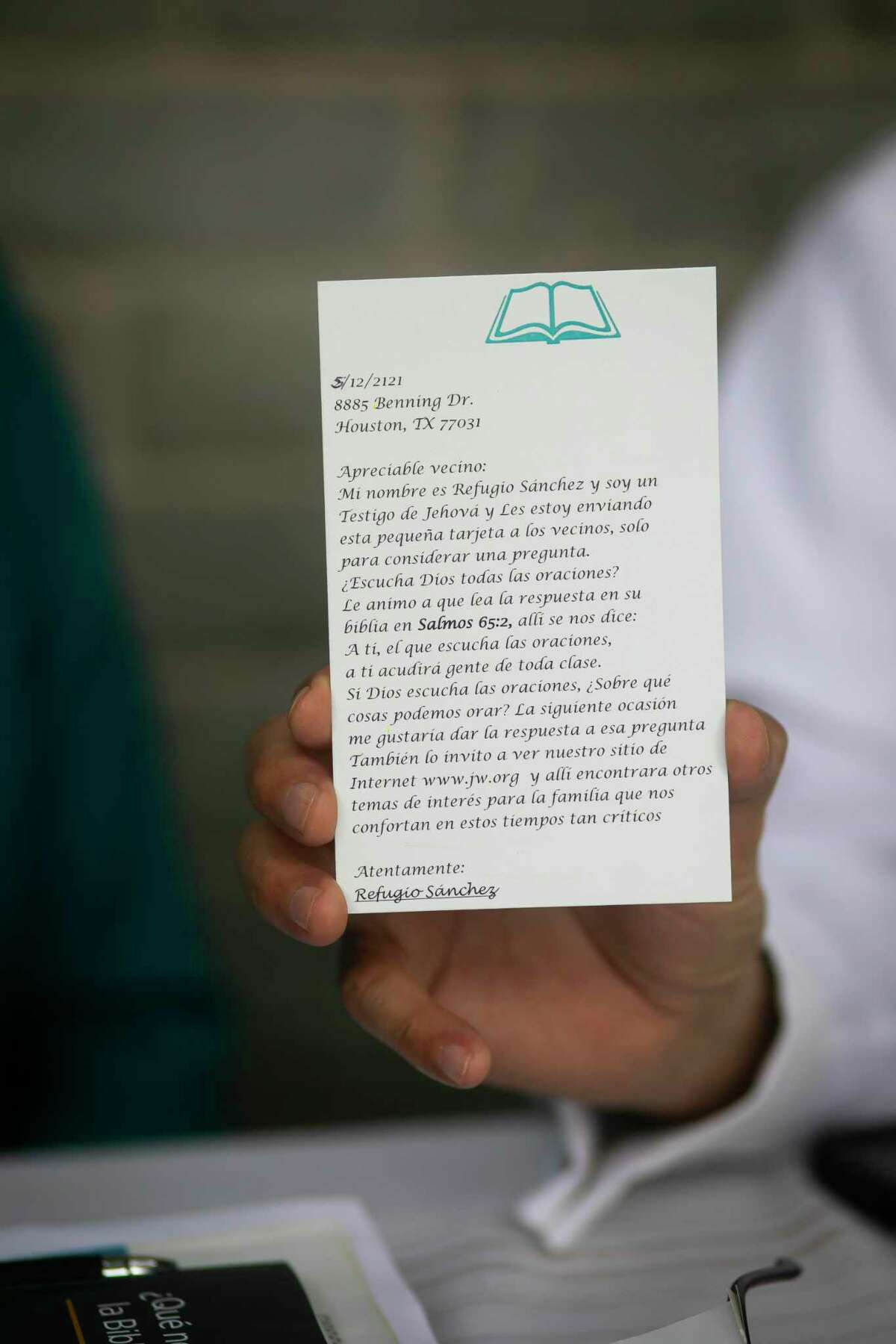 Refugio Sanchez holds up a copy of the postcard he sends prisoners as a part of his 18-year prison ministry on Monday, June 7, 2021. Sanchez and his wife Raquel, who are Jehovah's Witnesses, switched from meeting prisoners in-person to letter-writing during the pandemic.