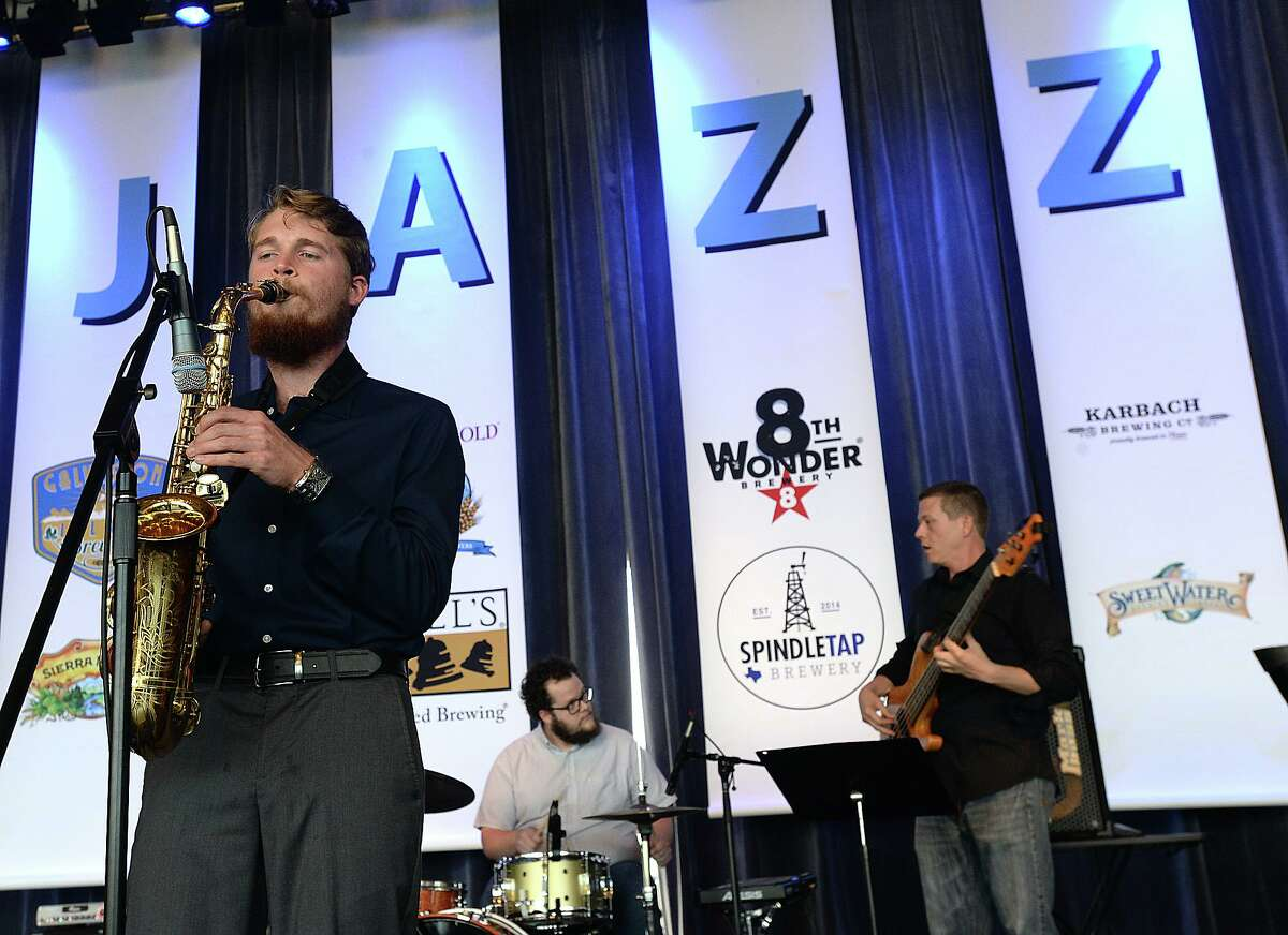 """The """"Colby Foretet"""" opens the night's performances at July's Jazz at the Lake performance at the Event Centre. Dean James Jazz was the featured performer at this month's series concert. Yoga on the patio, an art exhibit and free beer sampling rounded out the evening's activities. Thursday, July 26, 2018 Kim Brent/The Enterprise"""