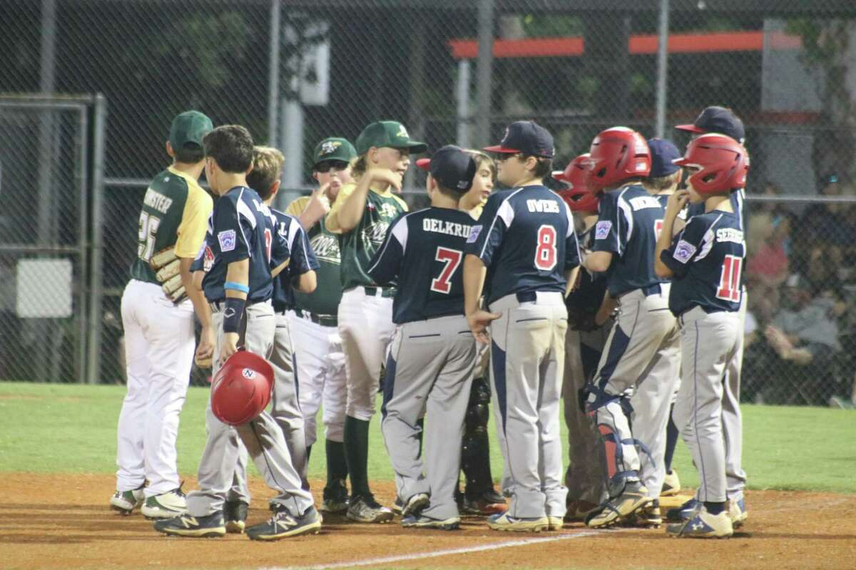 The 11-year-old all-stars from NASA Area Little League and Santa Fe mingle and get to know each other while the adults debated about a rules clarification that stopped Thursday night's game for a very long time.