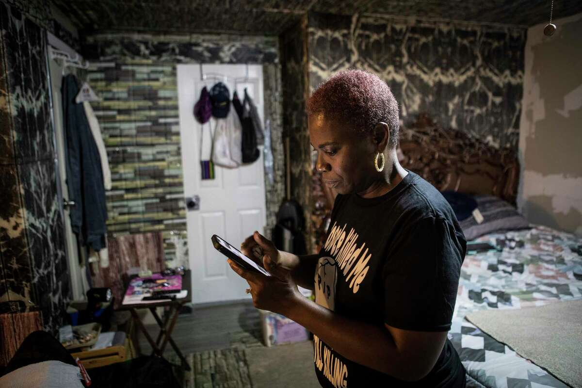 Sandra Edwards stands in her 5th Ward home Wednesday, June 23, 2021 in Houston. Edwards' home sits in the middle of a cancer cluster near a rail yard that creosote contamination is blamed for several cancer related deaths.