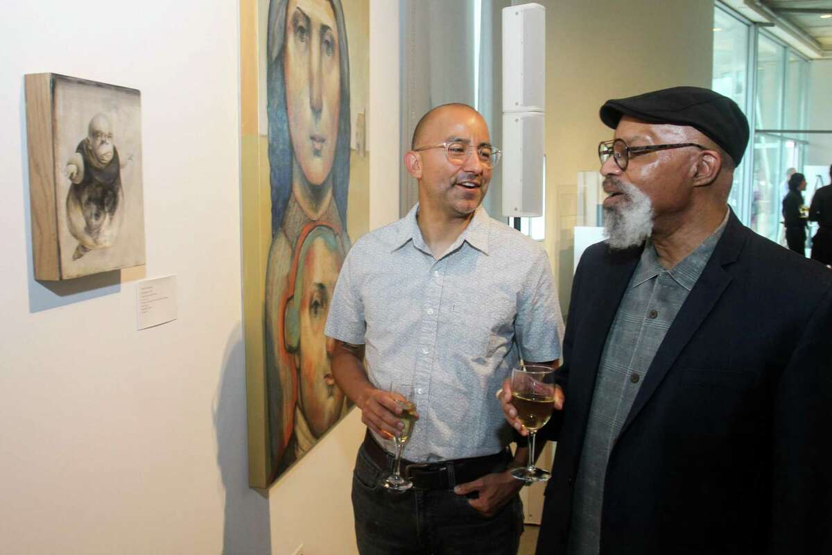 Vincent Valdez, left, and Romeo Robinson at the Glassell Art Auction at the Glassell School of Art in Houston on June 24, 2021.