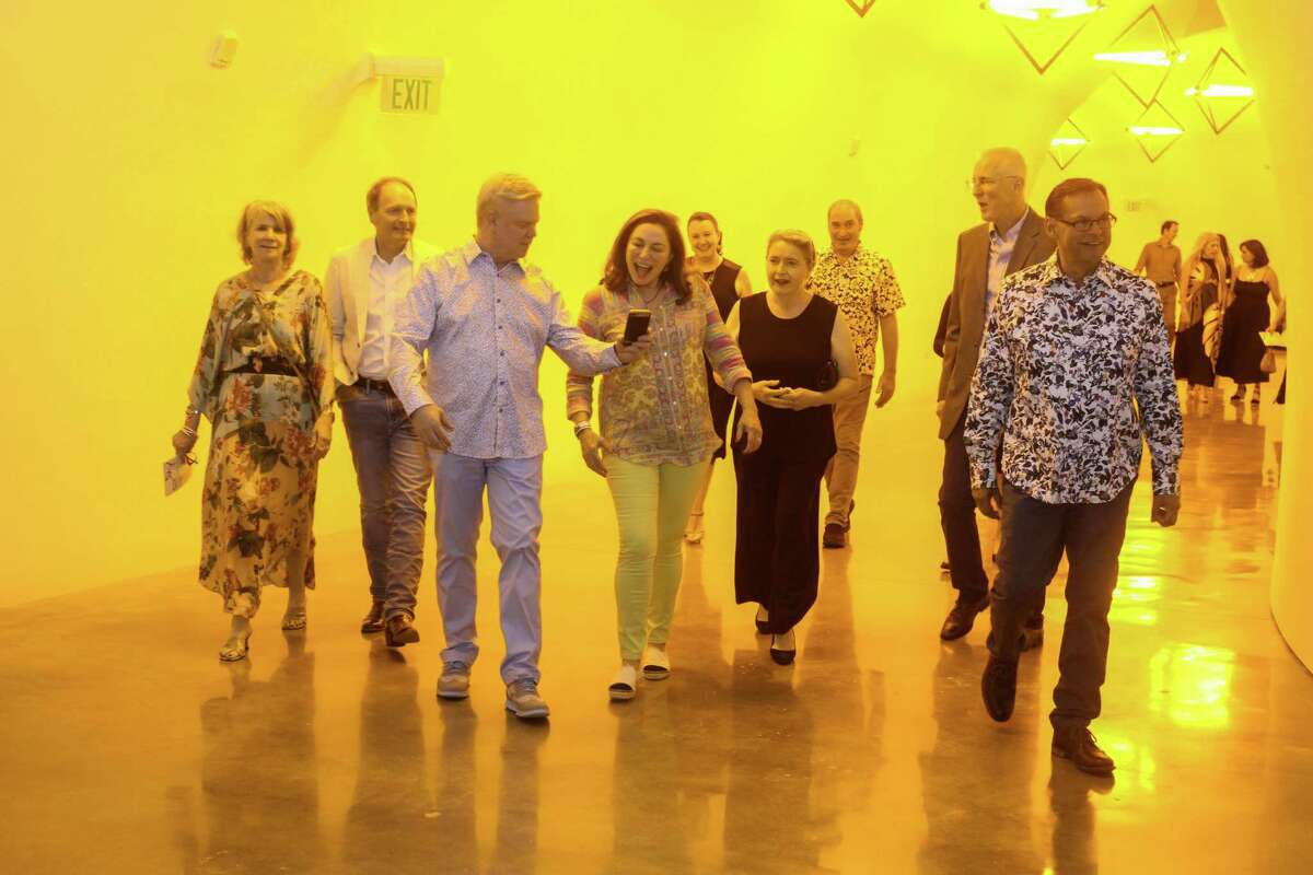 Guests move from the Glassell School to the newly completed Nancy and Rich Kinder Building for dinner via the Olafur Eliasson tunnel. at the Glassell Art Auction in Houston on June 24, 2021.
