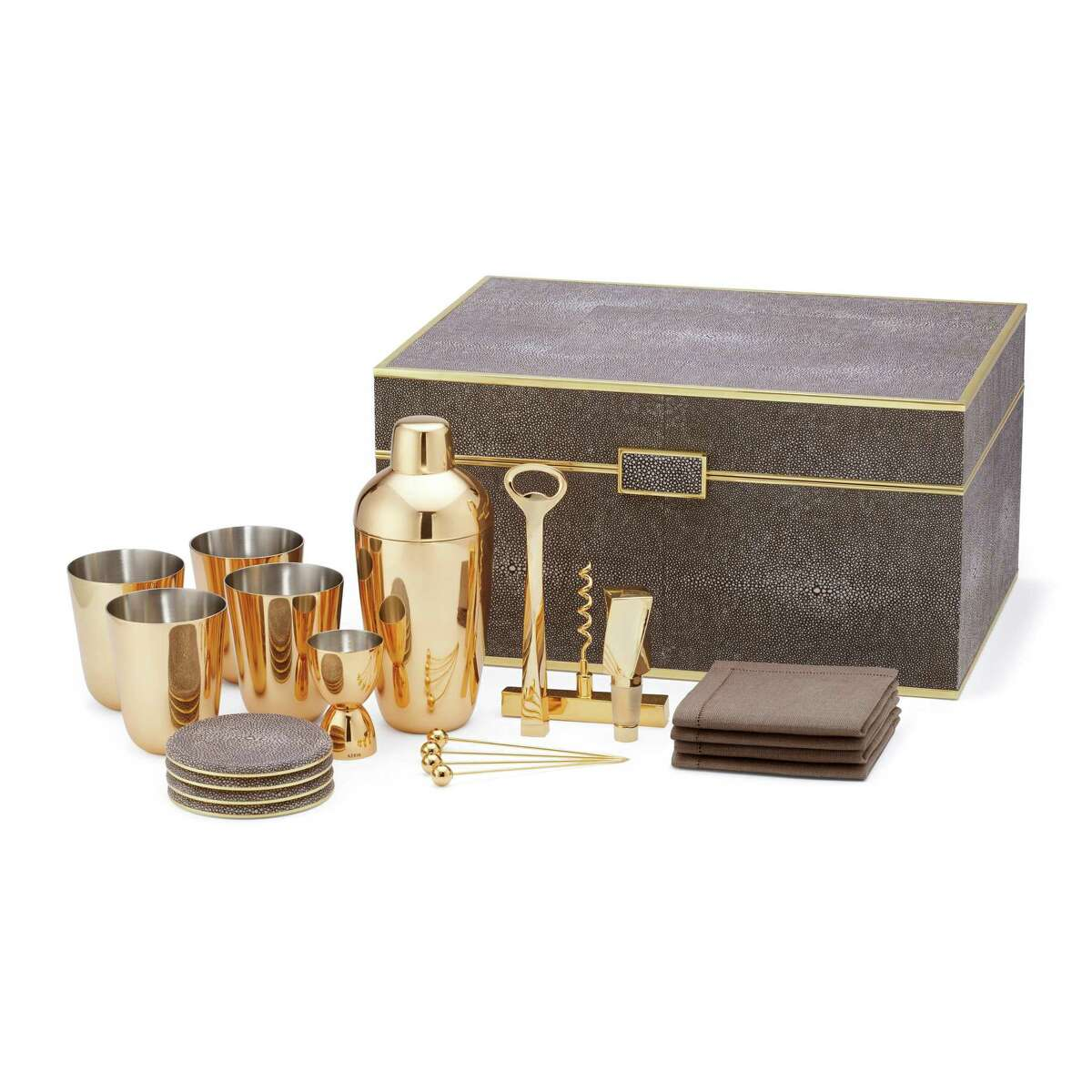 Brass, suede and shagreen combine for the ultimate bar collection for any mixologist. The set - by Aerin and in cream or chocolate finish - includes three removable trays, bar tools, a jigger, shaker set, cocktail picks, julep cups, napkins and shagreen coasters, all in a shagreen covered box. $5,371; amara.com