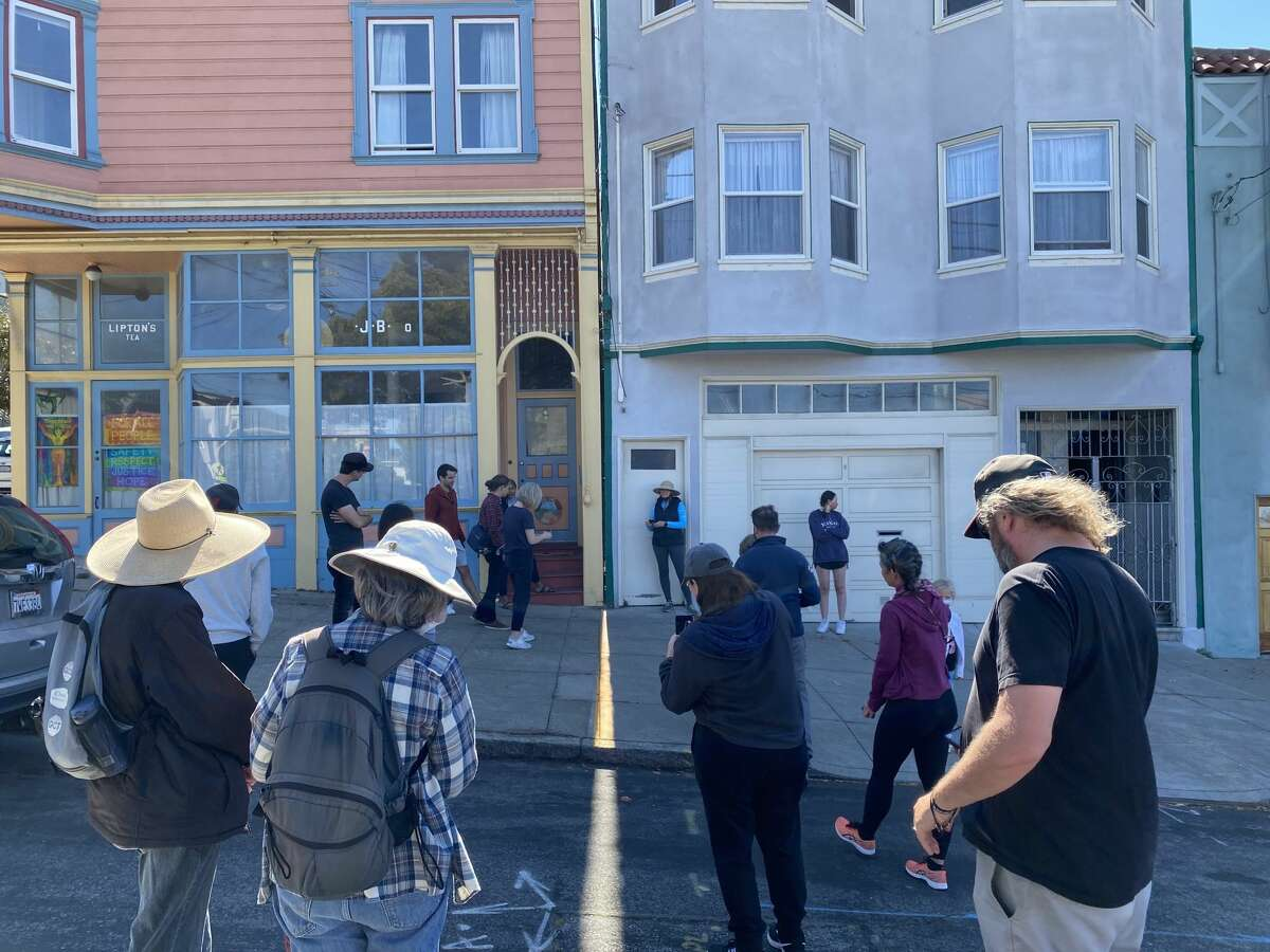 People gather around the sun solstice crack in Noe Valley on Thursday, June 24, 2020.