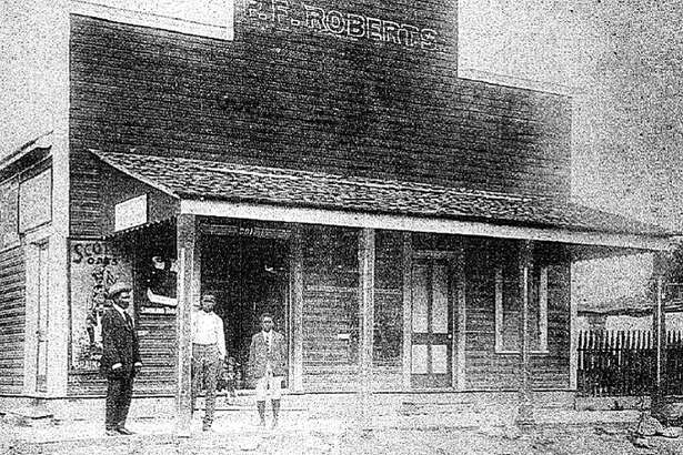 Roberts in front of his store on what was then Victoria Street.