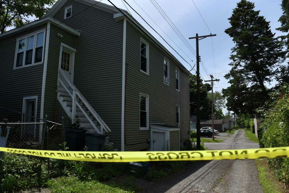 Police crime tape is placed across an alley behind 311 3rd Street where a newborn's skeletal remains were discovered on Friday, June 25, 2021, in Watervliet, N.Y. (Will Waldron/Times Union)