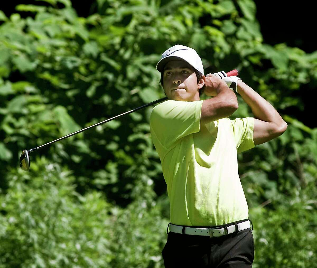 Jason Morilla watches his drive on the 13th hole during the 75th Greenwich Men's Town Golf Tournament at Griffith E. Harris Golf Course. Sunday, June 23, 2019