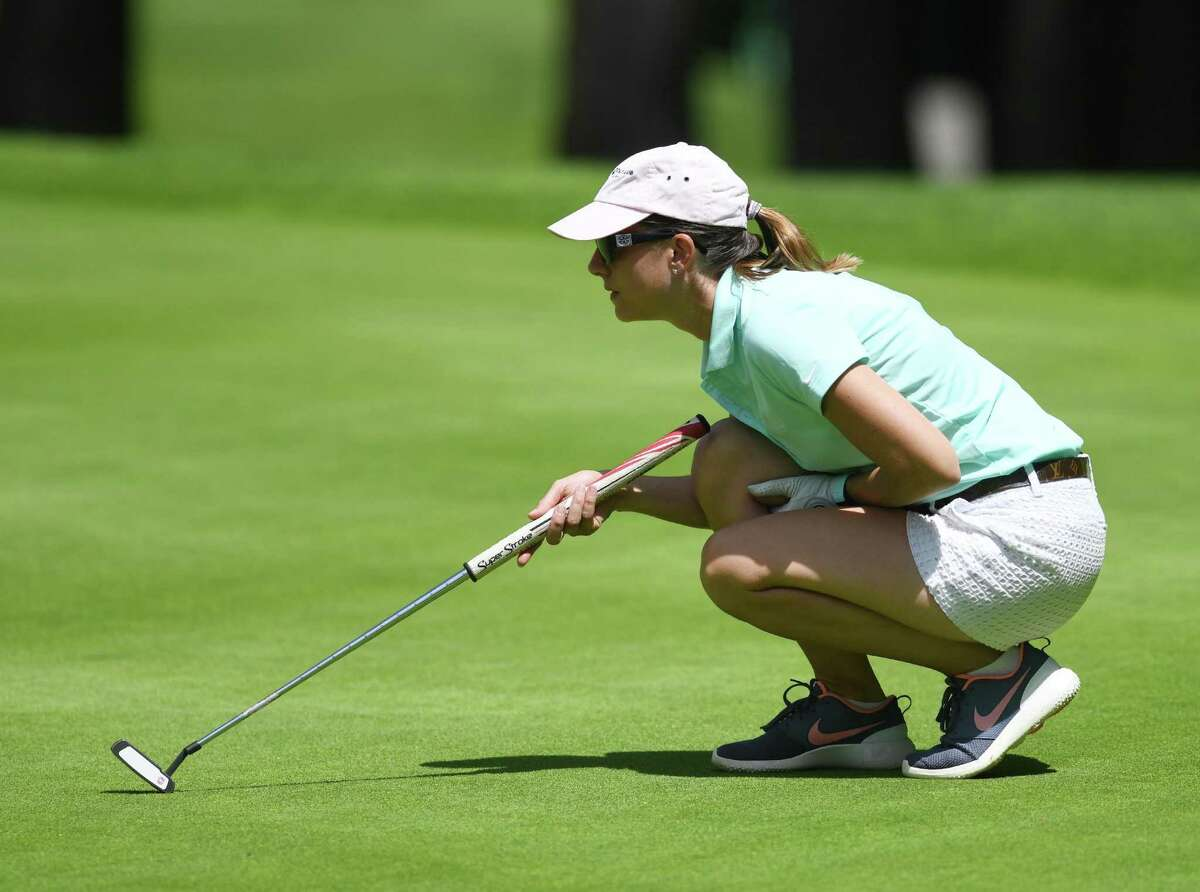 Anne-Laure Coby lines up a putt in the Greenwich Women's Town Wide Golf Tournament at Griffith E. Harris Golf Course in Greenwich, Conn. Monday, June 24, 2019. Anne-Laure Coby defended her town wide championship by shooting a 79.