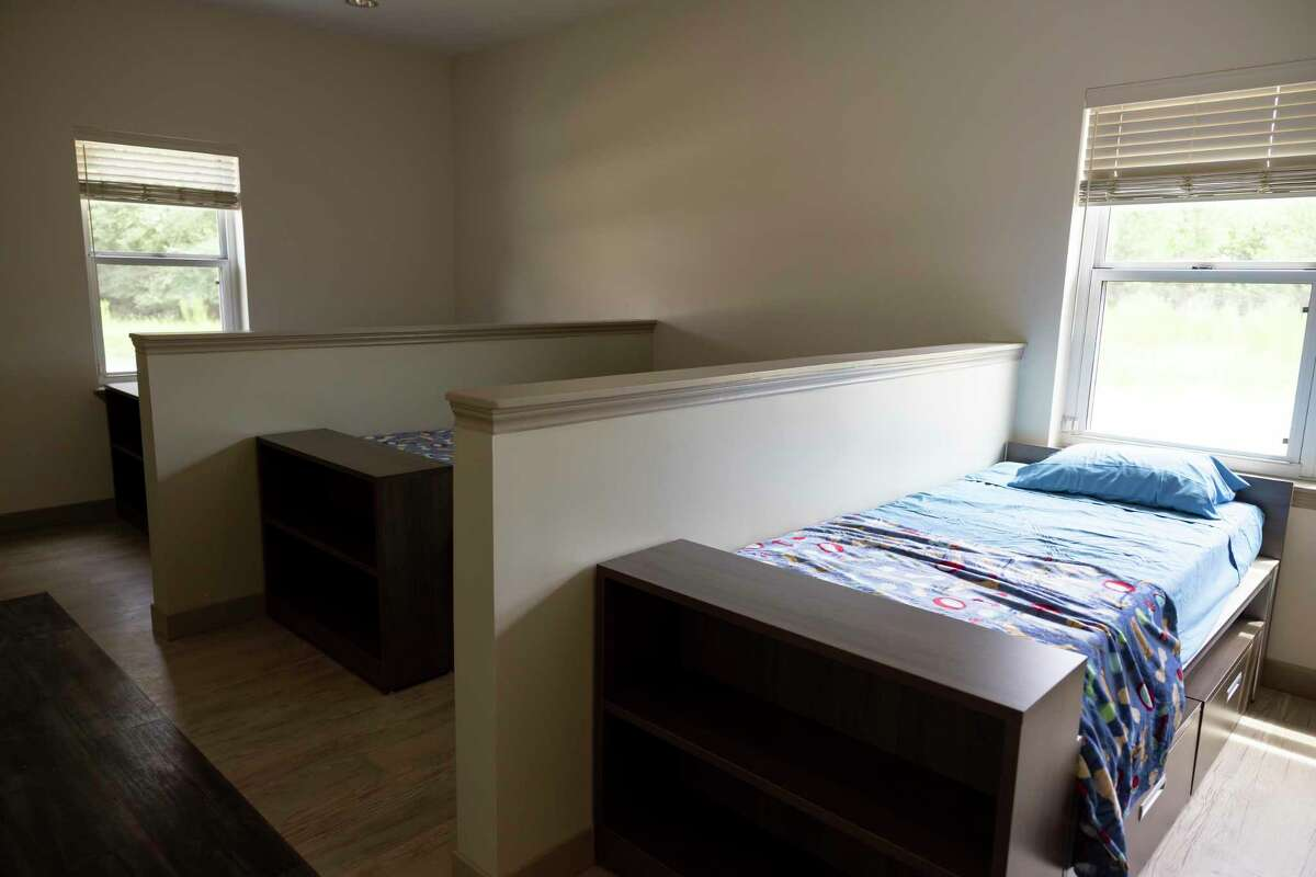 A three bedroom space is seen at Yes To Youth's new youth shelters, Thursday, June 24, 2021, in Conroe. The new shelters doubled the capacity at which they can accept youth, from 15 at their own building to 30.