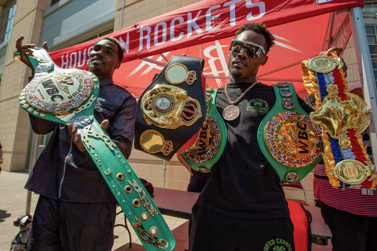 Jermall and Jermell Charlo show off their championship belts outside Toyota Center on Wednesday, June 16, 2021.