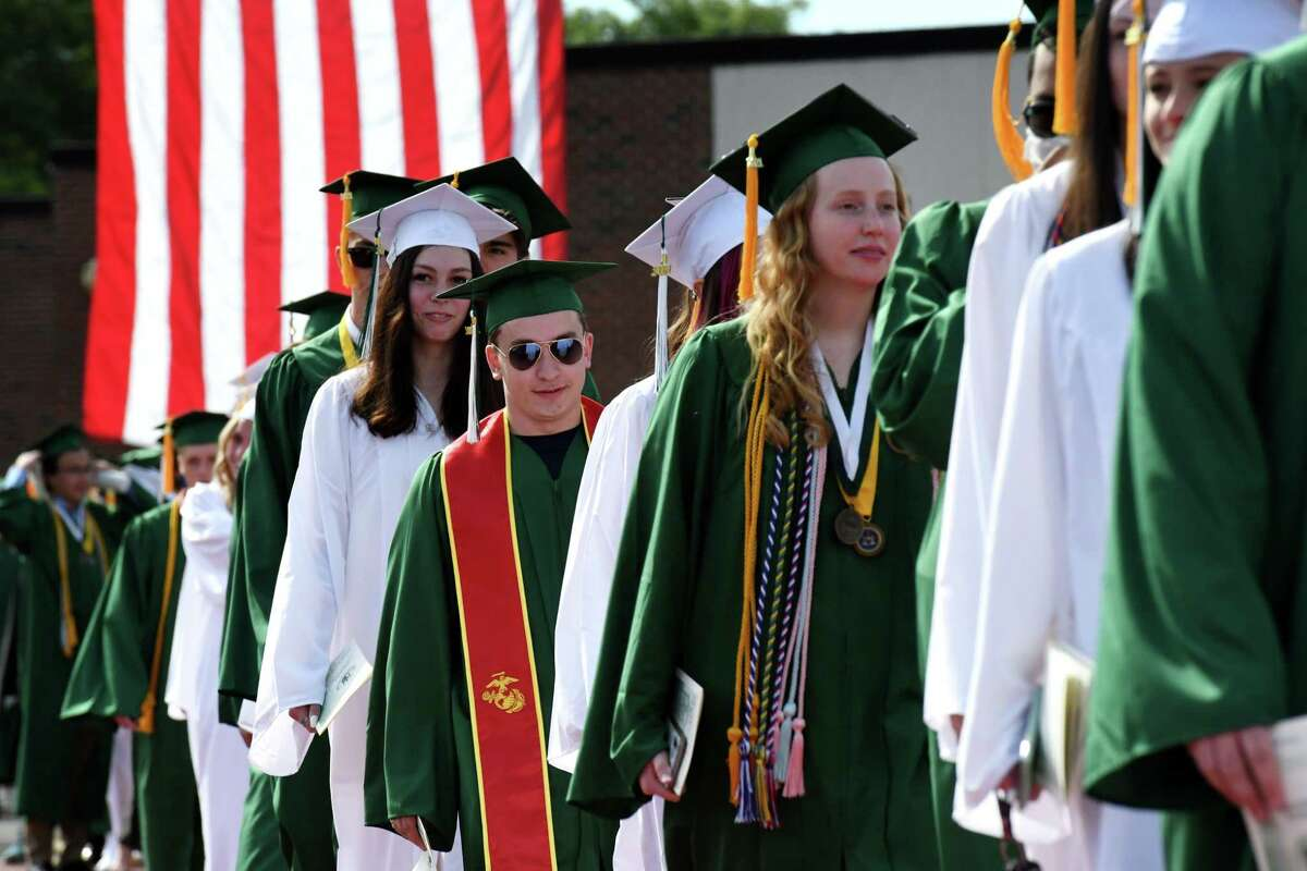 Shenendehowa High School graduates make their way into Brent T. Steuerwald Plainsmen Stadium to begin commencement exercises on Friday morning, June 25, 2021, in Clifton Park, N.Y. (Will Waldron/Times Union)