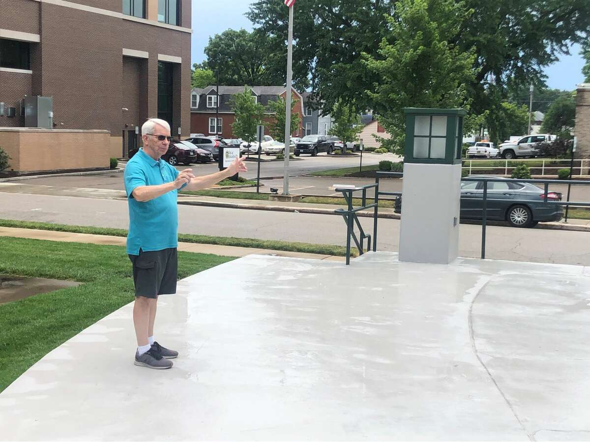 Jim Kerfoot, the bandleader of the Edwardsville Municipal band, poses for a photo at the City Park bandstand