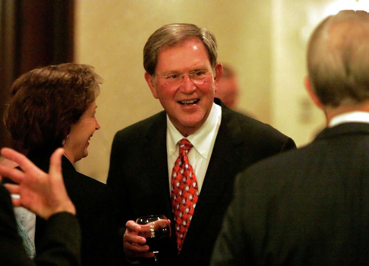 San Antonio Express-News former publisher and CEO Larry Walker talks with guests at his retirement party in 2006. Walker improved journalism in San Antonio, and he also dug into the community in lasting ways.