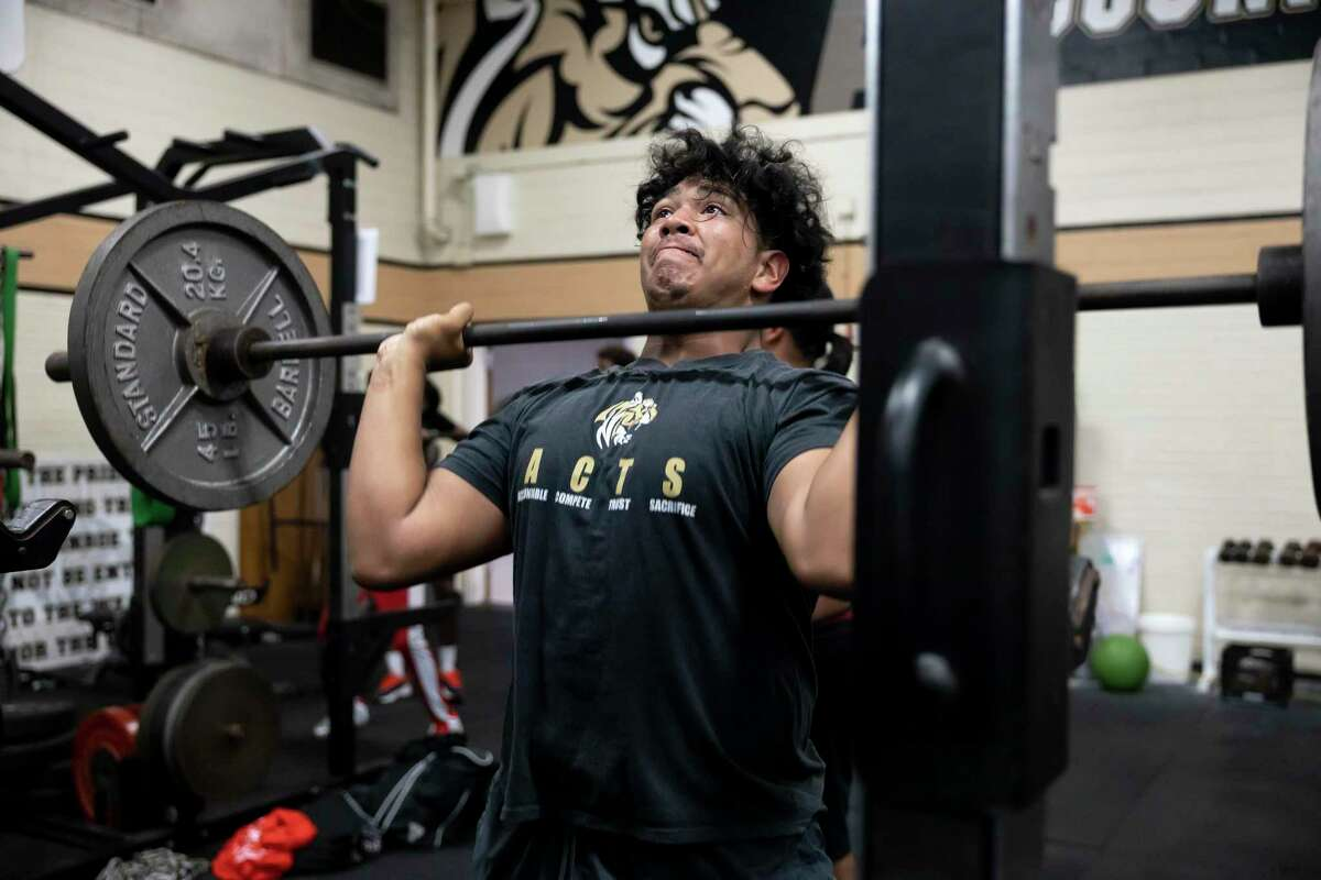 Jose Singh lifts weights during Strength and Conditioning camp at Buddy Moorhead Stadium, Thursday, June 24, 2021, in Conroe. Last summer, these camps were one of the first things to return, though deeply impacted by the COVID-19 pandemic.