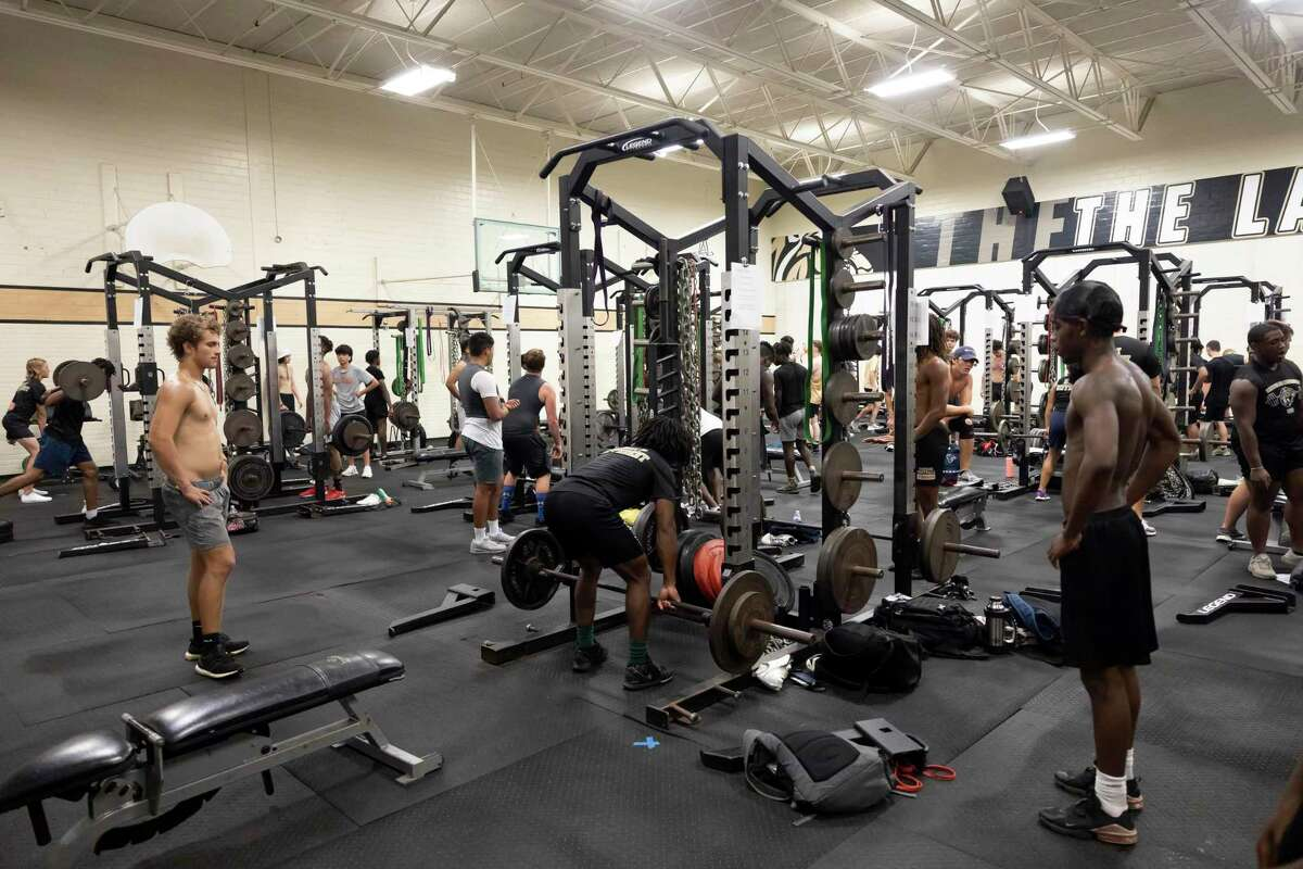 Conroe High School football players use the weight room during Strength and Conditioning camp, Thursday, June 24, 2021, in Conroe. Last summer, these camps were one of the first things to return, though deeply impacted by the COVID-19 pandemic.
