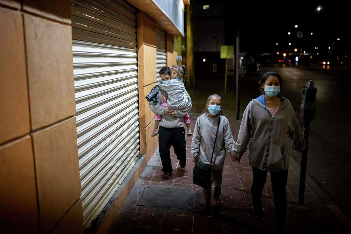 A husband and wife and their two daughters from Honduras walk through downtown Juarez moments after being deported from El Paso under Title 43 back into Mexico, Thursday, March 25, 2021, in Juarez, Mexico. Photo by Ivan Pierre Aguirre