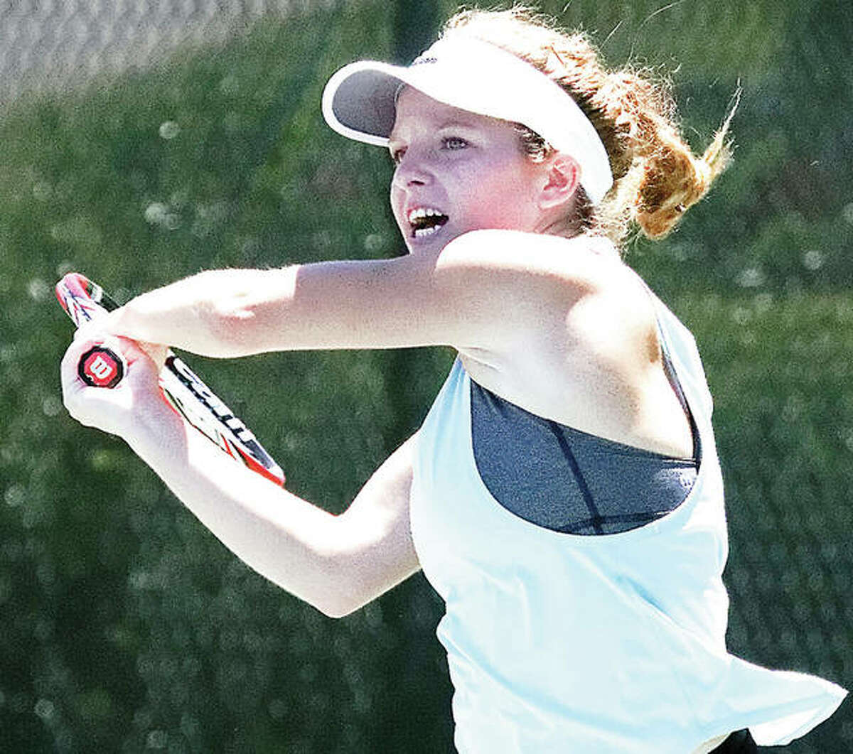Janelle Wilson of Godfrey makes a return in a previous Alton Open Tennis Tournament. After a summer off because of the pandemic, Alton's summer tennis tournament are back.
