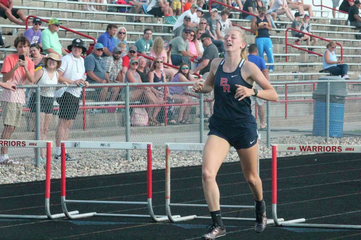 Big Rapids hurdler Makenna Rautio finishes her 300 race at the regional meet. (Pioneer file photo)
