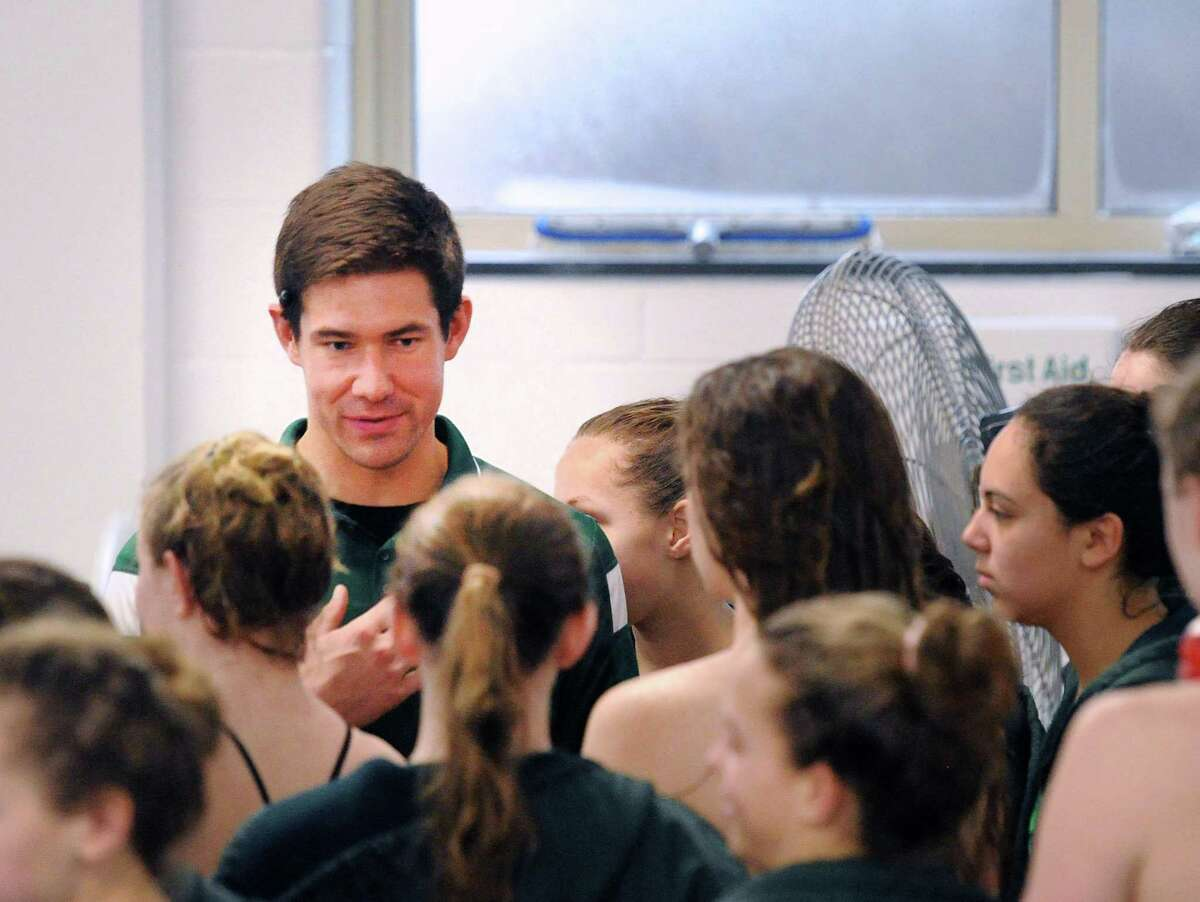 Sacred Heart Greenwich swimming coach Brendan Heller speaks with his team prior to the start of the girls high school swimming meet between Sacred Heart Greenwich and Westover School at Sacred Heart in Greenwich, Conn., Wednesday, Jan. 18, 2017.