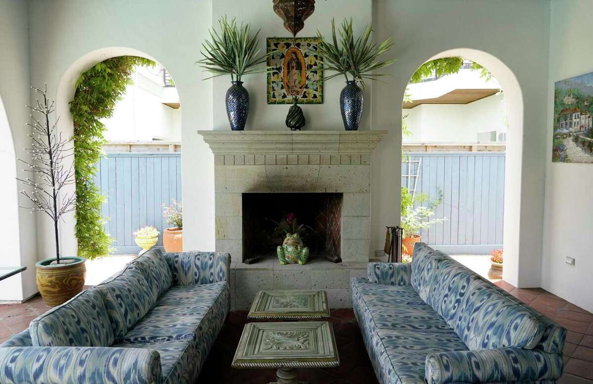 Carla and Denny McMahon's backyard pavilion has a blue-and-white themed seating area.
