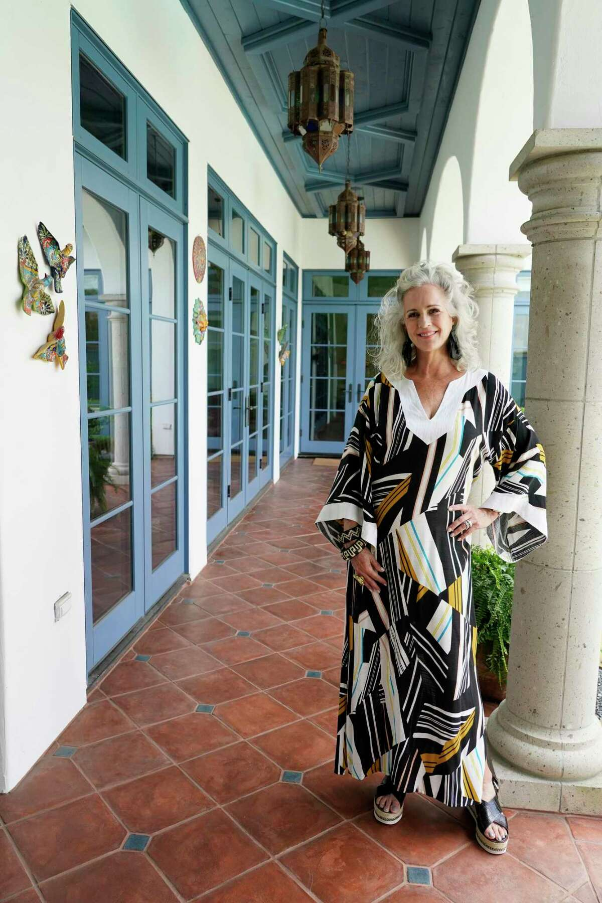 Carla McMahon designs and sells caftans, and has decorated her home in Spanish Colonial style circa 1920s California.