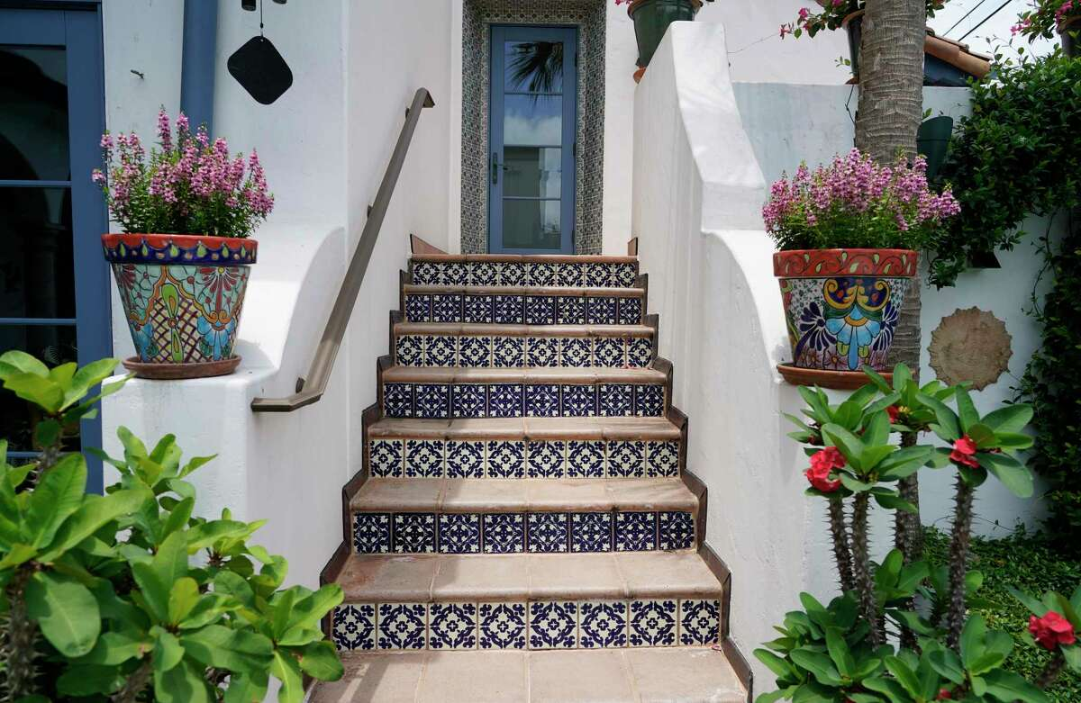 Outdoor stair risers alternate different patterns of Mexican Talavera tile.