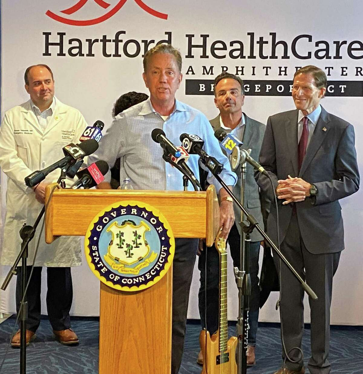 Gov. Ned Lamont unveiled the state's Rock the Shot vaccine incentive Friday at the Hartford Healthcare Amphitheater.