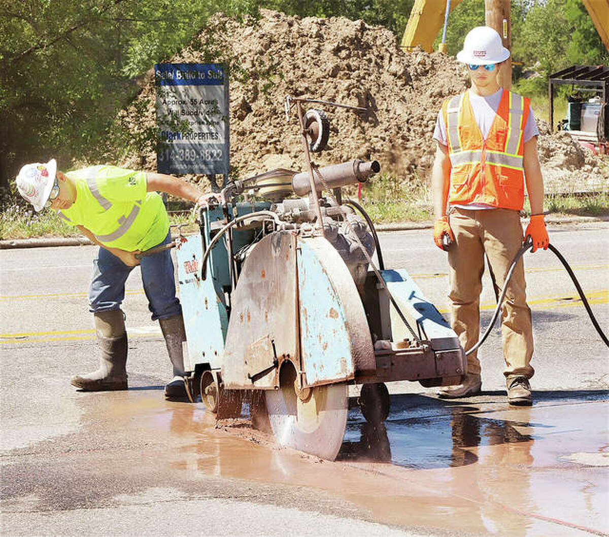 Workers used a giant saw Wedbnesday to cut through the pavement on East Broadway between Washington Avenue and Pearl Street as part of a major sanitary sewer project.
